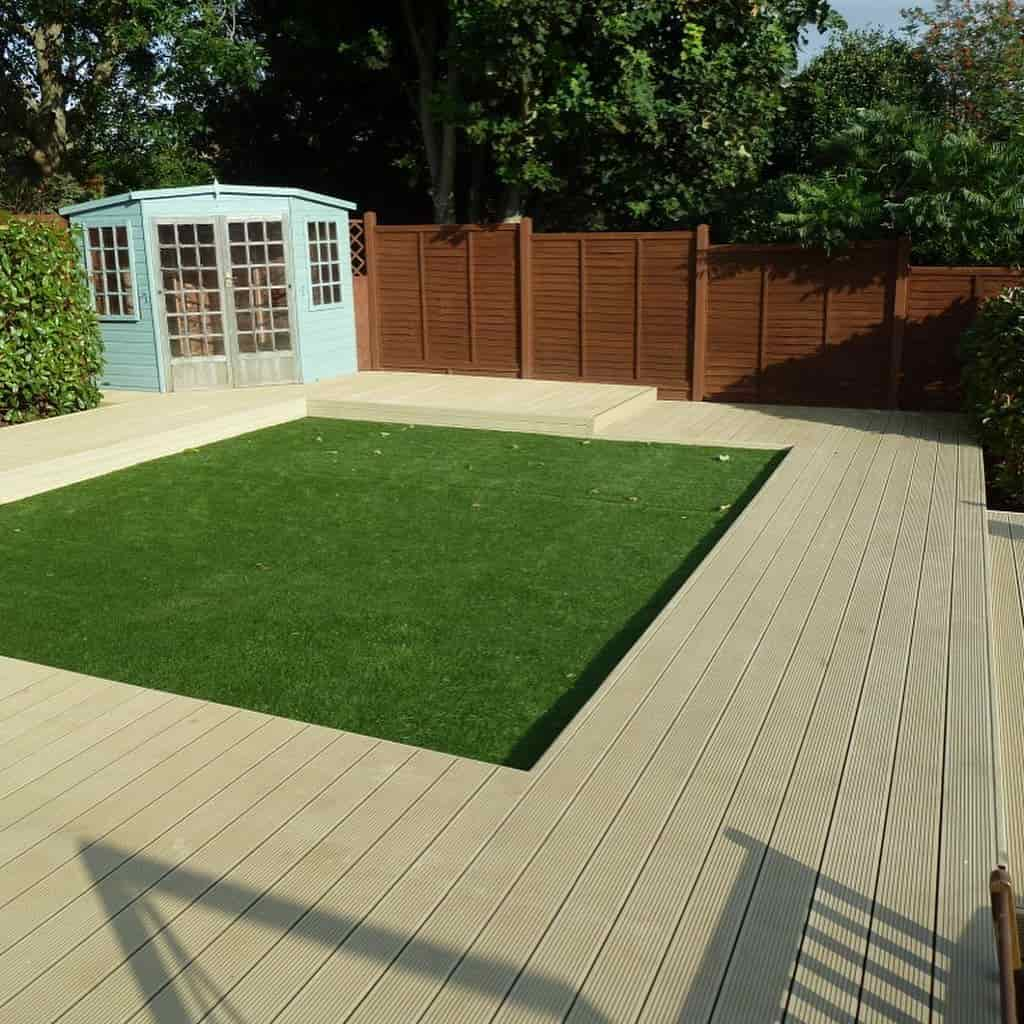 Landscaping work involving artificial grass and wooden decking