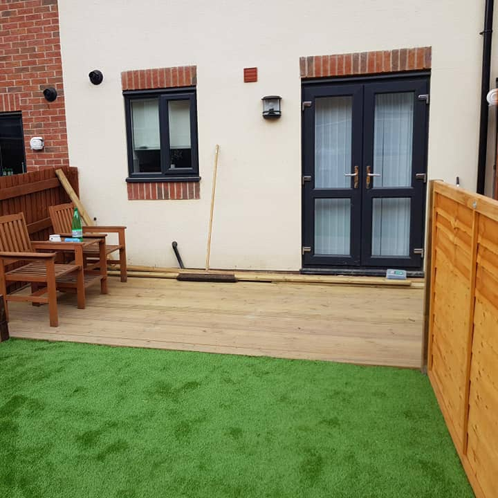 Artificial grass and decking laid in small London garden