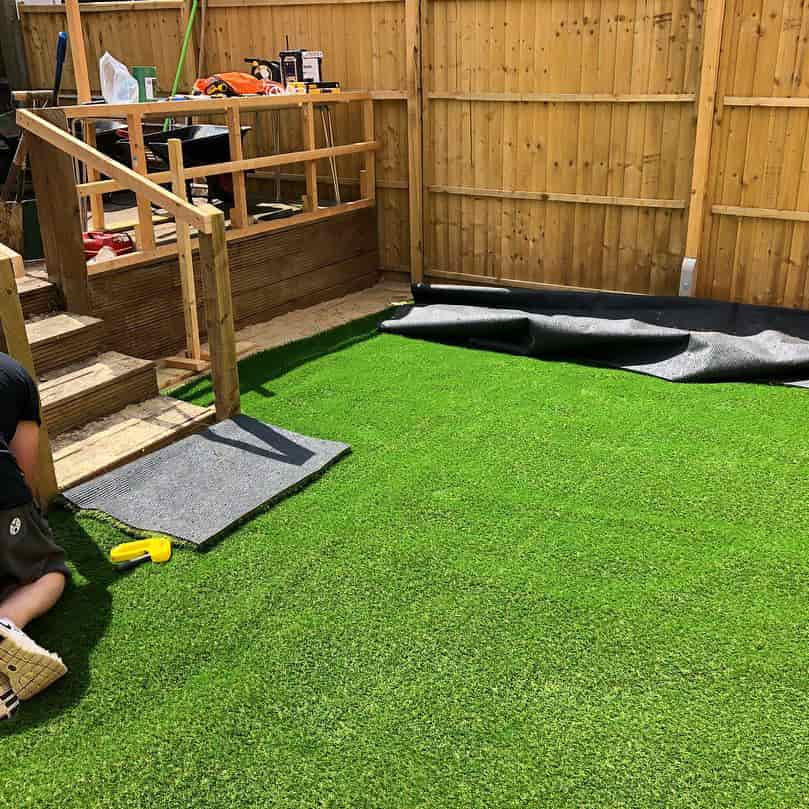 PTS landscaping specialist laying artificial grass
